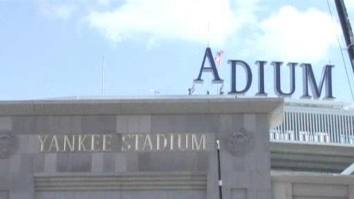 Frame grab of an MLB.com video, showing workers lowering the 'A' into position to the left of 'DIUM', forming a temporary 'ADIUM'.